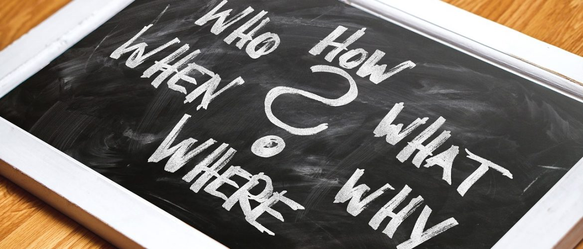 Chalk board that says How? Who? When? Where? What? Why? on our FAQs page.